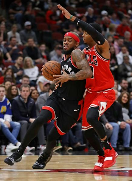Toronto's Lorenzo Brown drives against Shaquille Harrison in a Raptors' win over the Bulls in Chicago