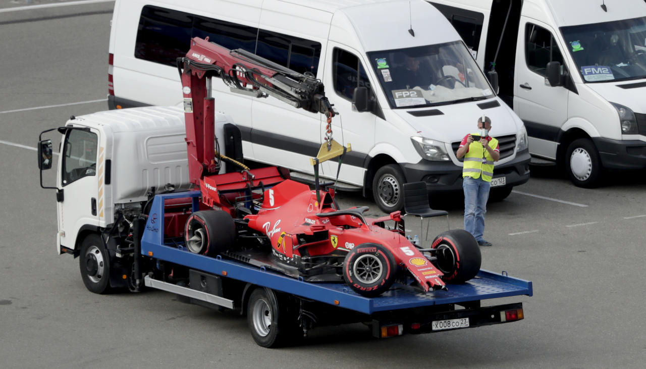 The car of Ferrari driver Sebastian Vettel of Germany sits on a flatbed truck after a crash during the qualifying session for the upcoming Russian Formula One Grand Prix, at the Sochi Autodrom circuit, in Sochi, Russia, Saturday, Sept. 26, 2020. The Russian Formula One Grand Prix will take place on Sunday. (AP Photo/Pavel Golovkin, Pool)