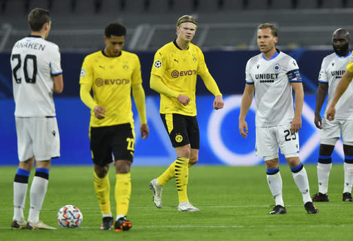 Dortmund's Erling Braut Haaland, center, celebrates after scoring the opening goal during the Champions League group F soccer match between Borussia Dortmund and Club Brugge in Dortmund, Germany, Tuesday, Nov. 24, 2020. (AP Photo/Martin Meissner)