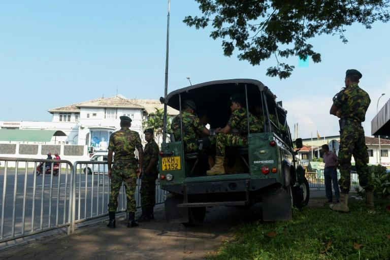 Special Task Force soldiers stand guard near Welikada prison as a protest by inmates entered a second day (AFP Photo/Lakruwan WANNIARACHCHI)