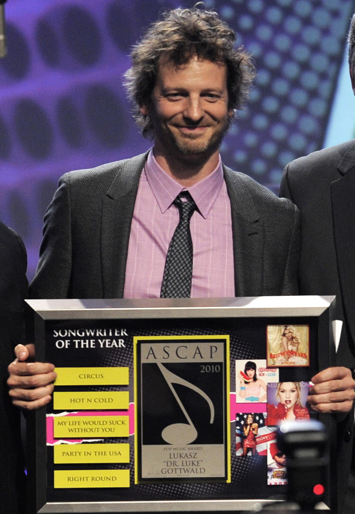 """FILE - Lukasz """"Dr. Luke"""" Gottwald accepts the Songwriter of the Year award at the 27th Annual ASCAP Pop Music Awards on April 21, 2010, in Los Angeles. The controversial music producer and hitmaker rose to the top of the Billboard charts with Doja Cat's ubiquitous funk-pop jam """"Say So,"""" along with Saweetie's anthemic bop """"Tap In"""" and Juice WRLD's Top 5 pop smash """"Wishing Well."""" He appeared as Tyson Trax on the Grammy ballot for Doja Cat's """"Say So,"""" which he produced and co-wrote. The hit tune is competing for record of the year, where he is contention as the song's producer. (AP Photo/Chris Pizzello, File)"""