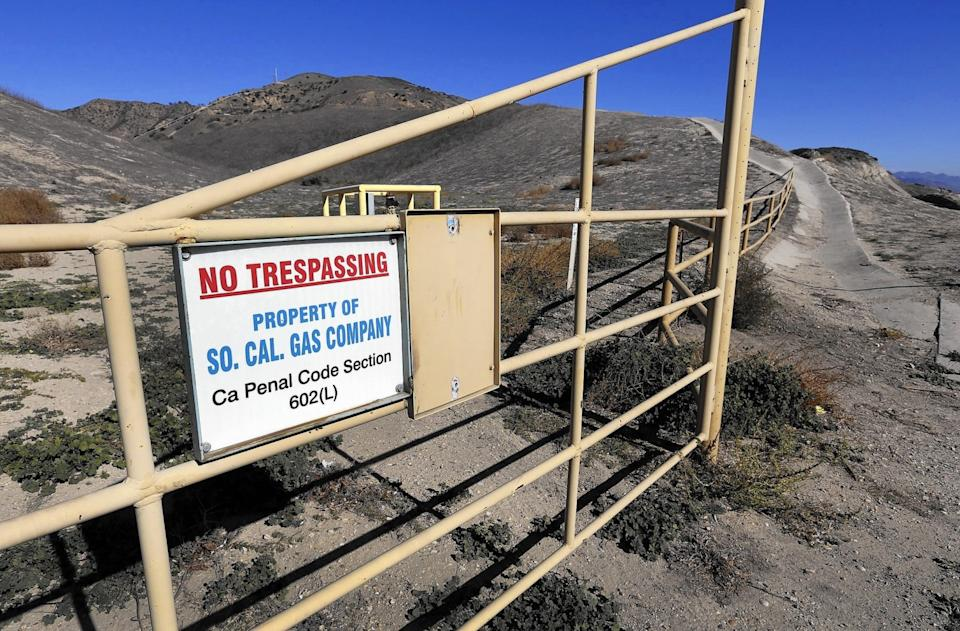 A sign on a metal gate says No Trespassing, Property of SoCal Gas Company