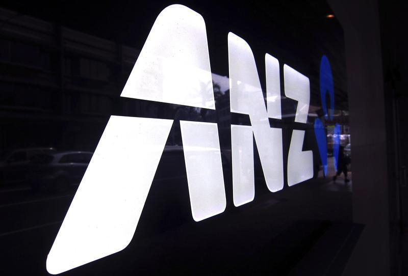 A man walks past a branch of the Australia and New Zealand Banking Group Ltd (ANZ) in Sydney