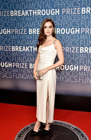 <p>Lily Collins wore a simple silk gown with beaded straps at the Breakthrough Prize event at the NASA Ames Research Center, Mountain View, USA. <em>[Photo: Getty]</em> </p>