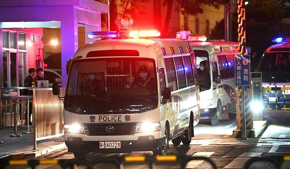 Police vehicles exit the Yantian People's Court in Shenzhen, where 12 Hong Kong fugitives were tried for illegal border crossing. Photo: AFP