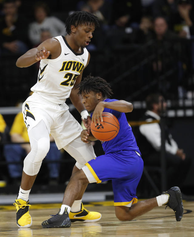 UKMC guard Xavier Bishop tries to drive past Iowa forward Tyler Cook, left, during the first half of an NCAA college basketball game, Thursday, Nov. 8, 2018, in Iowa City, Iowa.(AP Photo/Charlie Neibergall)