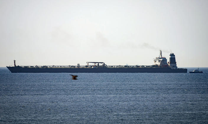 FILE - In this file photo dated Thursday, July 4, 2019, Grace 1 super tanker is anchored near a Royal Marine patrol vessel off the coast of the British territory of Gibraltar. A newspaper in Gibraltar is reporting Thursday Aug. 15, 2019, that the United States has applied to seize the Iranian supertanker Grace 1, that authorities in the British overseas territory are seeking to release from detention. (AP Photo/Marcos Moreno, FILE)