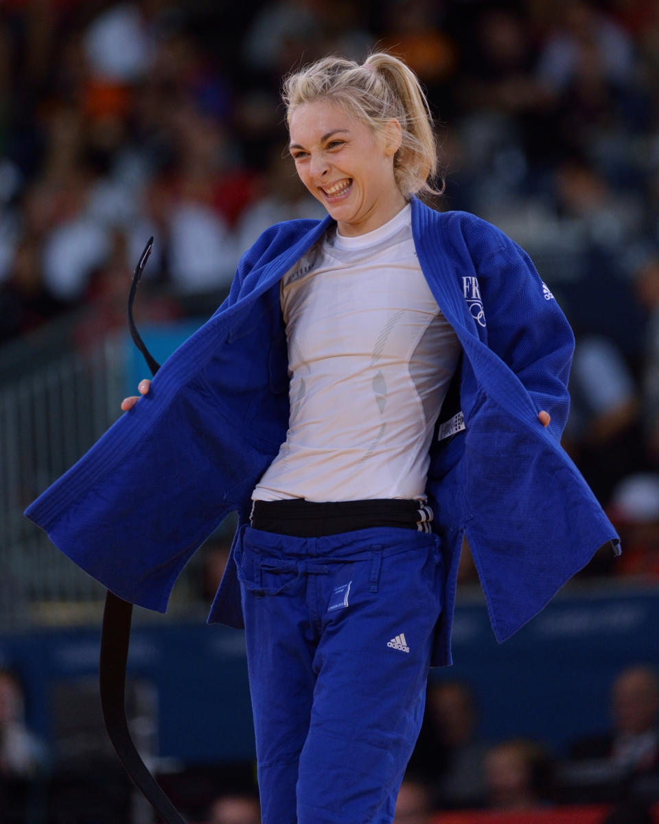 LONDON, ENGLAND - JULY 30: Automne Pavia of France celebrates after winning the Bronze Medal B in the Women's -57kg Judo on Day 3 of the London 2012 Olympic Games at ExCeL on July 30, 2012 in London, England. (Photo by David Finch/Getty Images)