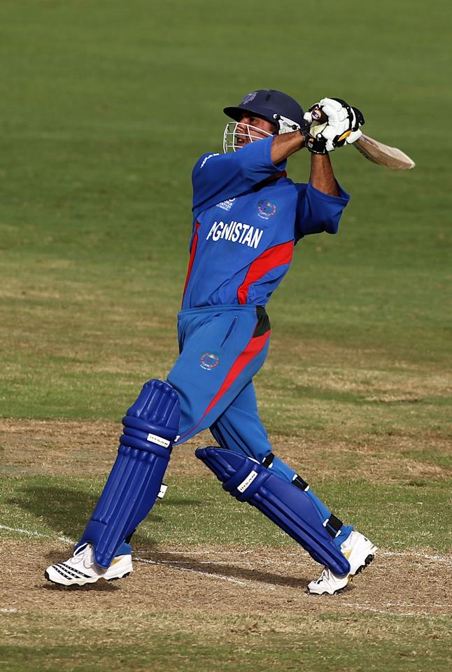 GEORGETOWN, GUYANA - APRIL 28:  Mohammad Nabi of Afghanistan in action during The ICC T20 World Cup warm up match between Ireland and Afghanistan at the Guyana National Stadium Cricket Ground on April 28, 2010 in Providence, Guyana.  (Photo by Clive Rose/Getty Images)