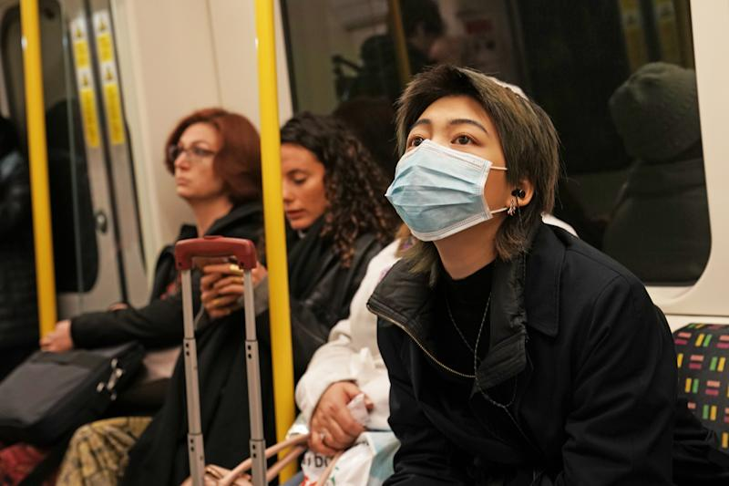 A woman wearing a face mask on the London Underground.