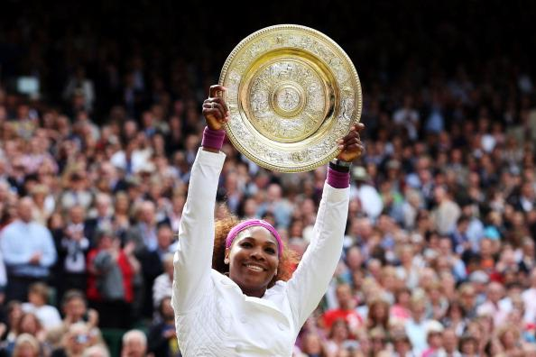 Serena Williams of the USA lifts the winners trophy and celebrates after her Ladies' Singles final match against Agnieszka Radwanska of Poland on day twelve of the Wimbledon Lawn Tennis Championships at the All England Lawn Tennis and Croquet Club on July 7, 2012 in London, England. (Photo by Julian Finney/Getty Images)