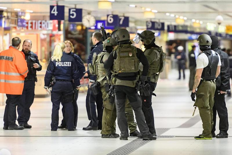Armed police: Officers descend on Dusseldorf station following the attack. (Getty Images)