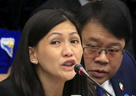 Maia Santos Deguito, branch manager of the Rizal Commercial Banking Corp (RCBC) answers questions during a money laundering hearing at Senate in Manila April 5, 2016. At right is her legal counsel Fernando Topacio.   REUTERS/Romeo Ranoco/File Photo