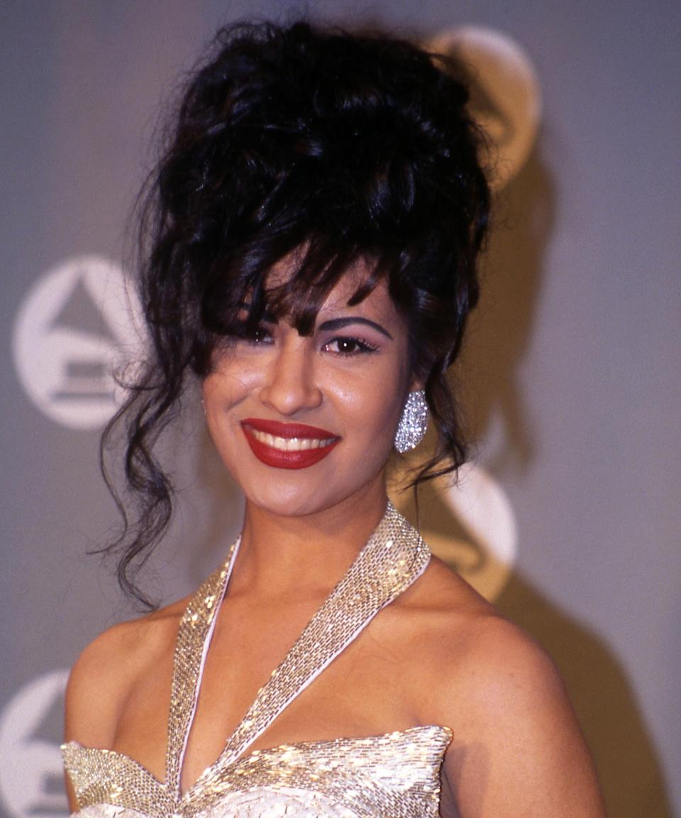 "<h3>Selena</h3><br><br>On stage, <a href=""https://www.refinery29.com/en-us/2020/05/9689669/selena-quintanilla-latinx-women-beauty-impact"" rel=""nofollow noopener"" target=""_blank"" data-ylk=""slk:Selena Quintanilla"" class=""link rapid-noclick-resp"">Selena Quintanilla</a> typically left her long black hair down, but she's often memorialized by her red-carpet appearance at the '94 Grammy Awards (after winning for Best Mexican/Mexican-American Album). There she sported a stunning updo with piece-y curls framing her face and her <a href=""https://www.refinery29.com/en-us/latinas-red-lipstick-meaning"" rel=""nofollow noopener"" target=""_blank"" data-ylk=""slk:signature red lip"" class=""link rapid-noclick-resp"">signature red lip</a>, of course.<span class=""copyright"">Photo: Vinnie Zuffante/Getty Images.</span>"