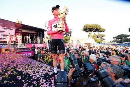 Cycling - Giro d'Italia, Rome, Italy - May 27, 2018 Team Sky's Chris Froome celebrates with the trophy after winning the Giro d'Italia REUTERS/Alessandro Garofalo