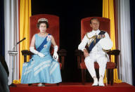 Queen Elizabeth II and the Duke of Edinburgh during the State Opening of Parliament in Bridgetown, Barbados, during her Silver Jubilee tour of the Caribbean.