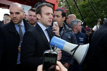 Emmanuel Macron, head of the political movement En Marche !, or Onwards !, and candidate for the 2017 French presidential election, uses a megaphone to talk to Whirlpool employees in front of the company plant in Amiens