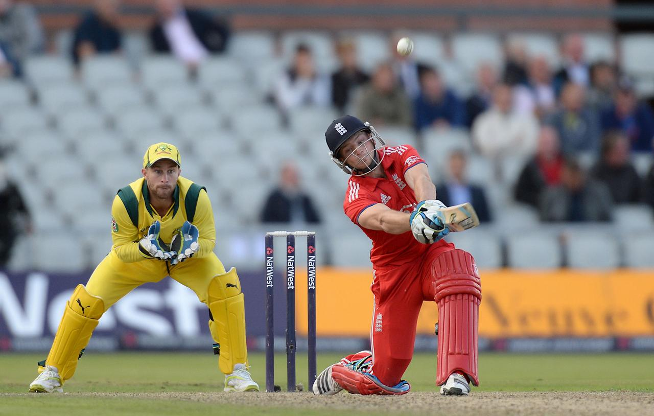 England's Jos Buttler hits out from the bowling oif Australia's Fawad Ahmed, during the Second One Day International at Old Trafford Cricket Ground, Manchester.