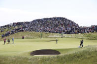 Northern Ireland's Rory McIlroy puts on the 6th green during the second round of the British Open Golf Championship at Royal St George's golf course Sandwich, England, Friday, July 16, 2021. (AP Photo/Ian Walton)