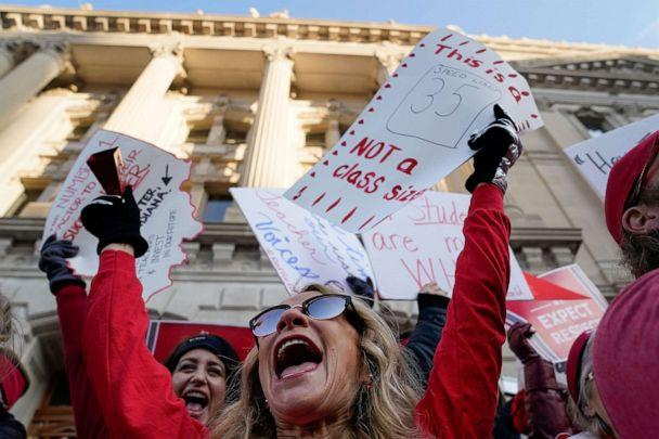 PHOTO: Candy Handy dances on the steps of the Capitol Building as teachers hold a one day walkout at the statehouse in Indianapolis, Nov. 19, 2019. (Bryan Woolston/Reuters)