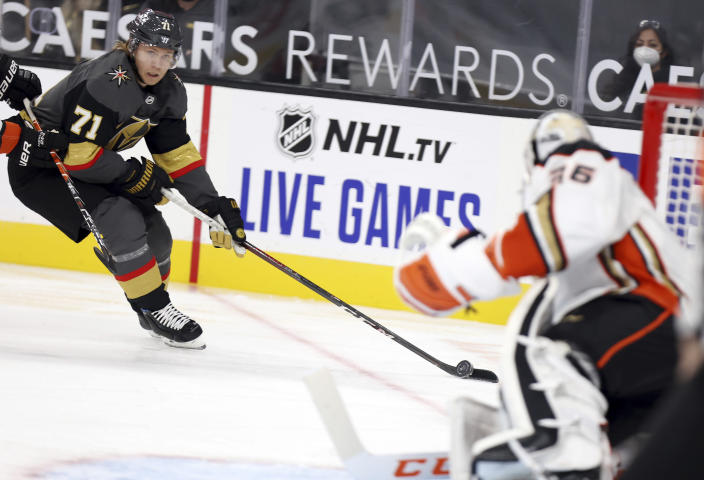 Vegas Golden Knights center William Karlsson (71) moves in on Anaheim Ducks goalie John Gibson (36) during the second period of an NHL hockey game Thursday, Jan. 14, 2021, in Las Vegas. (AP Photo/Isaac Brekken)