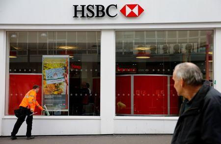 A window cleaner works at a branch of HSBC in Leicester