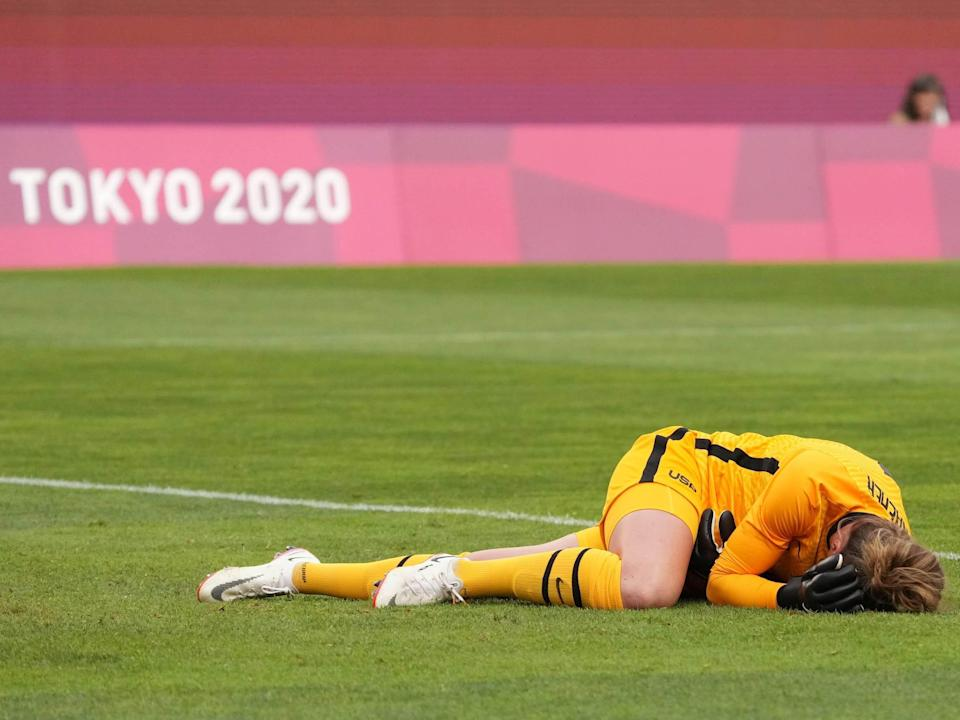 Alyssa Naeher lays on the turf following a first-half collision during the USWNT game vs Canada.