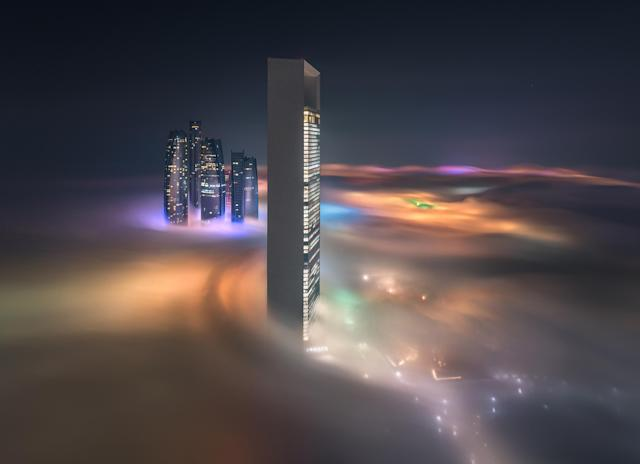 <p>Night view of ADNOC headquarters (foreground) and Etihad towers.(Photograph by Khalid Alhammadi/Caters News) </p>