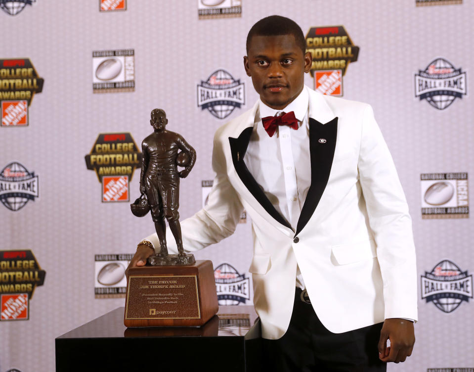 Georgia's Deandre Baker poses with the trophy after winning the Jim Thorpe Award as top defensive back in college football Thursday, Dec. 6, 2018, in Atlanta. (AP)