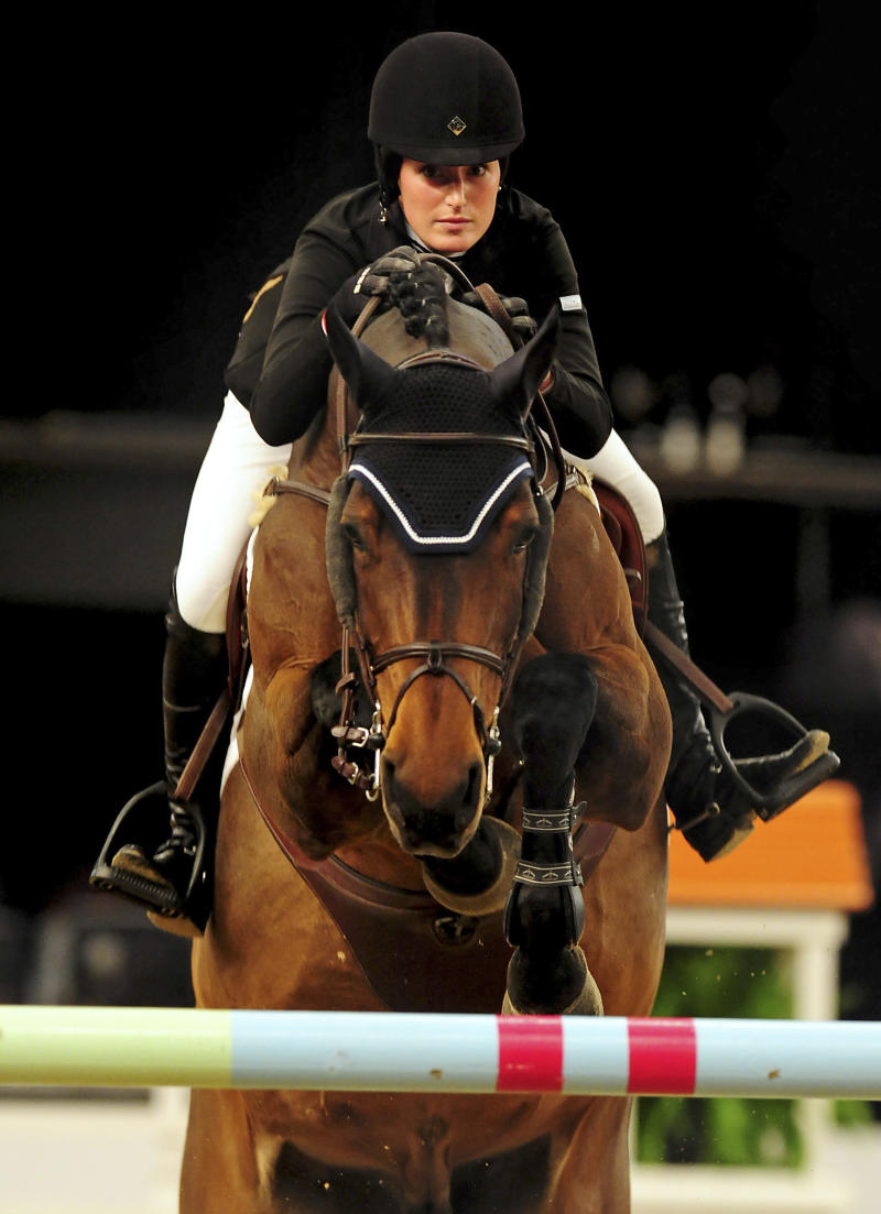 FILE-  photo dated October 6 2011 of Jessica Springsteen riding in Birmingham England. Olympic gold medallist Peter Charles' London 2012 horse Murka's Vindicat W has been sold to Jessica, the  daughter of rock star Bruce Springsteen.  Springsteen, an American international showjumper, will now ride the 10-year-old gelding that secured team gold for Great Britain at the London Olympics 2012  (AP Photo/Rui Vieira/PA file) UNITED KINGDOM OUT - NO SALES - NO ARCHIVES
