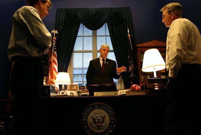"<span class=""caption"">Mike Pence meets with staff at his office in 2005.</span> <span class=""attribution""><a class=""link rapid-noclick-resp"" href=""https://www.gettyimages.com/detail/news-photo/congressman-mike-pence-meets-with-staff-at-his-office-on-news-photo/576539032?adppopup=true"" rel=""nofollow noopener"" target=""_blank"" data-ylk=""slk:The Washington Post/Getty Images"">The Washington Post/Getty Images</a></span>"