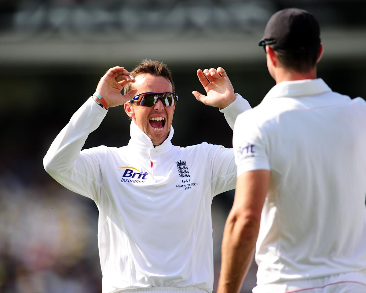 England's Graeme Swann celebrates taking the wicket of Australia's Shane Watson caught by Kevin Pietersen during day five of the Fifth Investec Ashes Test match at The Kia Oval, London.
