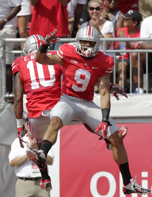 Ohio State wide receiver Devin Smith, right, celebrates his touchdown against Buffalo with wide receiver Corey Brown during the first quarter of an NCAA college football game Saturday, Aug. 31, 2013, in Columbus, Ohio. (AP Photo/Jay LaPrete)
