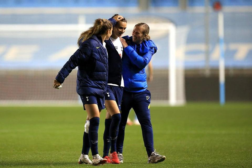 Head coach Rehanne Skinner with Rosella Ayane and Shelina Zadorsky after the 2-1 win over Manchester City (Tottenham Hotspur FC via Getty I)