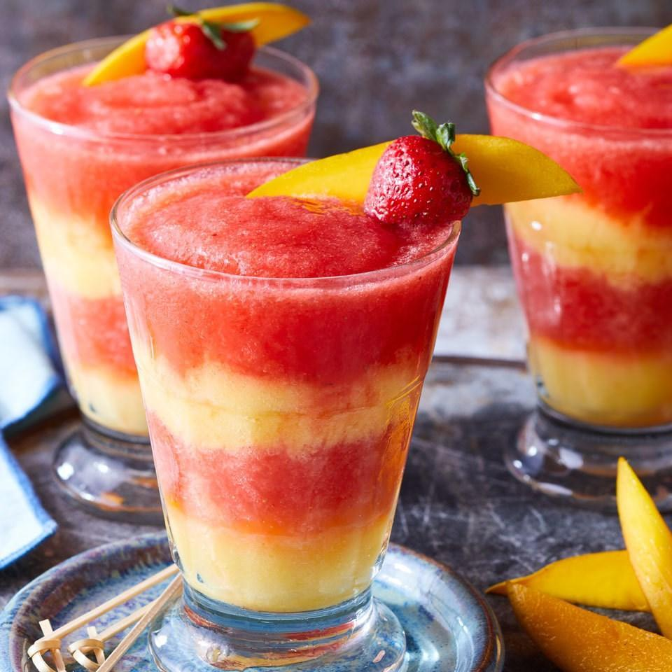 <p>Swirl layers of red strawberry margarita with yellow mango margarita in this skinny frozen cocktail for a festive party drink that will wow your guests. It tastes just as good as a restaurant frozen margarita, without all the sugar!</p>