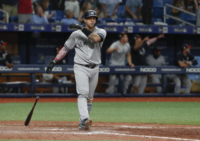 New York Yankees' Gary Sanchez drops his bat after hitting a three-run home run against the Tampa Bay Rays during the 10th inning of a baseball game Thursday, July 4, 2019, in St. Petersburg, Fla. (AP Photo/Scott Audette)