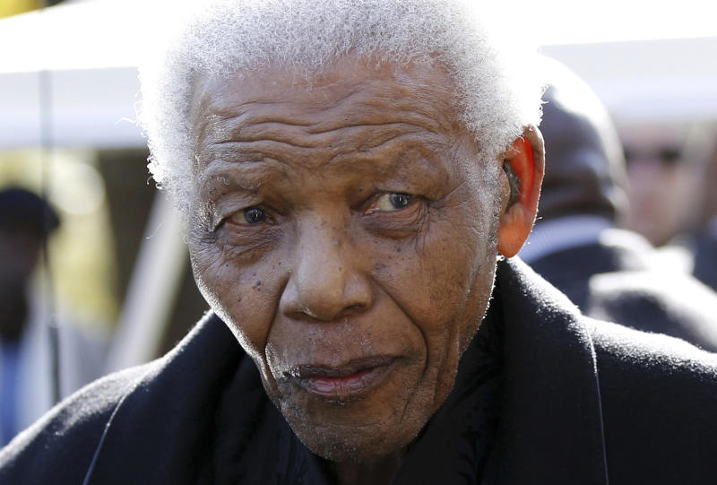 FILE - In this June 17, 2010 file photo, former South African President Nelson Mandela leaves the chapel after attending the funeral of his great-granddaughter Zenani Mandela in Johannesburg, South Africa. The South African presidency says Mandela has been discharged, Saturday, April 6, 2013, from a hospital after an improvement in his condition. Officials say he was treated for pneumonia. (AP Photo/Siphiwe Sibeko, Pool, File)