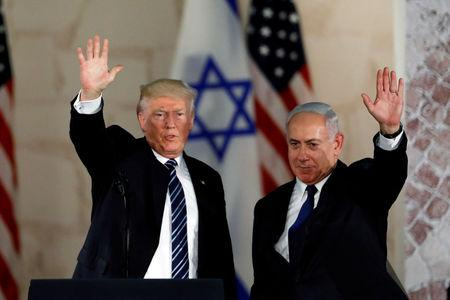 FILE PHOTO: U.S. President Donald Trump and Israeli Prime Minister Benjamin Netanyahu wave after Trump's address at the Israel Museum in Jerusalem May 23, 2017. REUTERS/Ronen Zvulun/File Photo