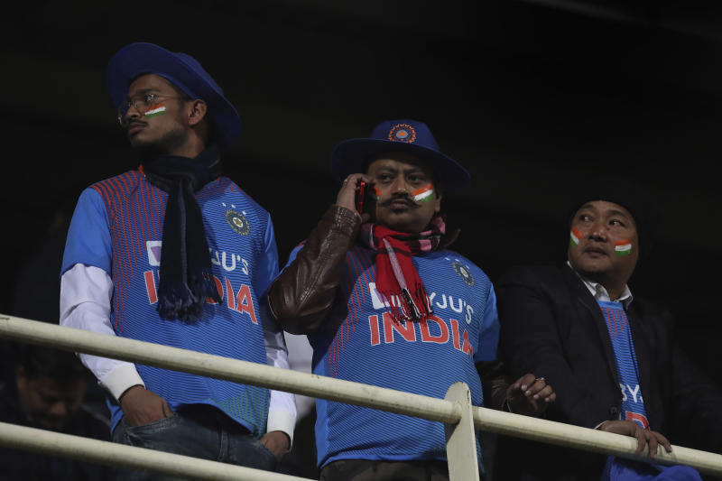 Indian spectators react after the match declared abandoned during the first Twenty20 cricket match between India and Sri Lanka in Gauhati, India, Sunday, Jan. 5, 2020. The match delayed for the rain. (AP Photo/Anupam Nath)