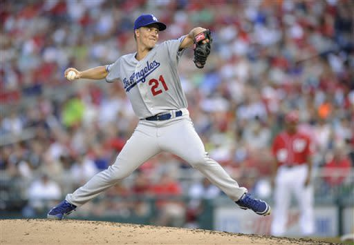 Los Angeles Dodgers starting pitcher Zack Greinke delivers a pitch against the Washington Nationals during the third inning of a baseball game, Saturday, July 20, 2013, in Washington. (AP Photo/Nick Wass)