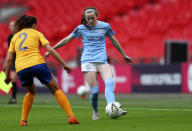 Manchester City's Rose Lavelle, right, duels for the ball with Everton's Ingrid Moe Wold during the Women's FA Cup final soccer match between Everton and Manchester City at Wembley stadium in London, Sunday, Nov. 1, 2020. (Cath Ivill/Pool via AP)