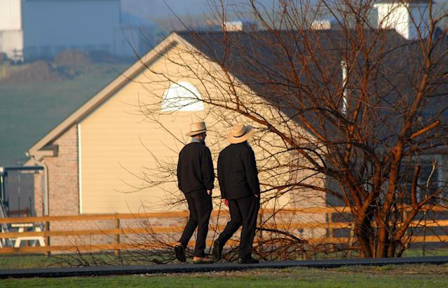 Amish men pass the newly built schoolhouse April 2, 2007 in Nickel Mines, Pennsylvania. (William Thomas Cain via Getty Images)