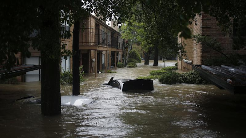 Six people in the same family, including four children, are presumed dead after floodwaters caused by Tropical Storm Harvey inundated their van on Sunday afternoon.