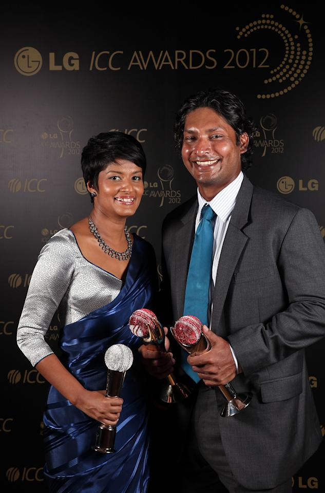 COLOMBO, SRI LANKA - SEPTEMBER 15:  Sri Lankan Kumar Sangakkara poses with his wife Yehali and the three trophies he won for ICC Cricketer of the Year (Sir Garfield Sobers Trophy) , ICC Test Cricketer of the Year 2012 and Peoples Choice Award at LG ICC Awards on September 15, 2012 in Colombo, Sri Lanka.  (Photo by Graham Crouch-ICC/ICC via Getty Images)