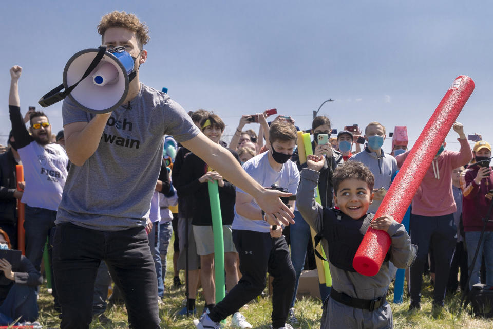 Josh Swain, left, declares Lincoln native four-year-old Joshua Vinson Jr., right, the ultimate Josh after the Josh fight took place in an open green space at Air Park on Saturday, April 24, 2021, in Lincoln, Neb. What started as a mid-pandemic joke took on life Saturday, as a mixed bag of individuals sharing only their name came to battle it out. The winner was to be declared the rightful owner of the name. (Kenneth Ferriera/Lincoln Journal Star via AP)