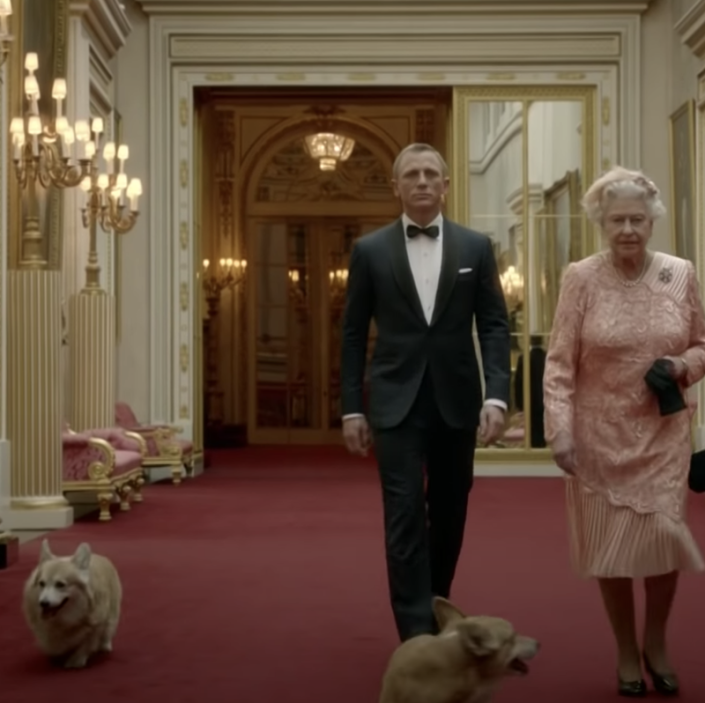 "<p>For the 2012 Olympics, the Queen and two of her dogs <a href=""https://www.youtube.com/watch?v=1AS-dCdYZbo&feature=emb_title"" rel=""nofollow noopener"" target=""_blank"" data-ylk=""slk:participated in a sketch"" class=""link rapid-noclick-resp"">participated in a sketch</a> with James Bond actor Daniel Craig. The corgis accompanied the Queen and Craig down the Buckingham Palace hallways, and even got to show off a couple of their tricks, like ""roll over.""</p>"