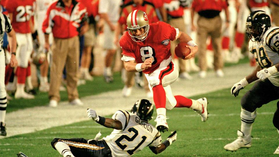 Young Gordon San Francisco 49ers' quarterback Steve Young (8) runs over San Diego's Darrien Gordon (21) for a first down during the first quarter of Super Bowl XXIX at Joe Robbie Stadium in Miami.