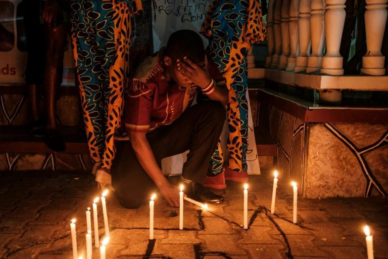 Members of the LGBTIQ community light candles as they take part in a vigil for the Transgender Day of Remembrance to remember victims of hate crimes in Kampala, Uganda in November 2019