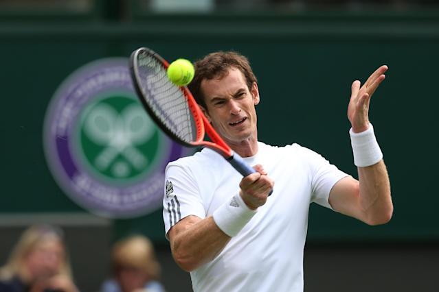LONDON, ENGLAND - JUNE 24: Andy Murray of Great Britain hits a forehand during his Gentlemen's Singles first round match against Benjamin Becker of Germany on day one of the Wimbledon Lawn Tennis Championships at the All England Lawn Tennis and Croquet Club on June 24, 2013 in London, England. (Photo by Clive Brunskill/Getty Images)
