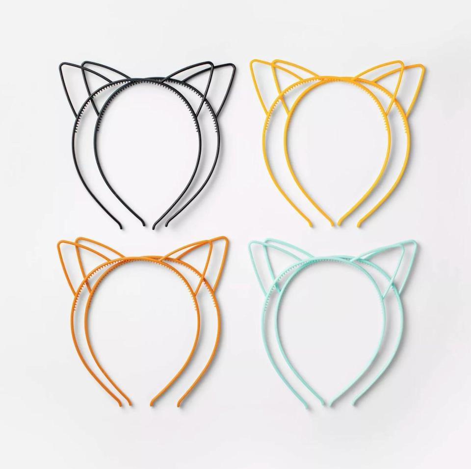 """<p>Your kiddos will love sporting these <span>Hyde & EEK! Boutique 8-Count of Cat Ear Plastic Headbands </span> ($3). Can we get a """"meow?""""</p>"""